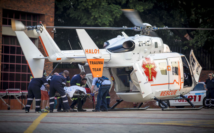 An bystander, injured in a shooting during a botched hijacking on Grayston Drive is airlifted from near the scene. Picture: Thomas Holder/EWN.