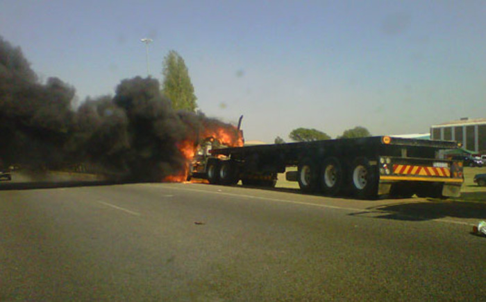 A truck was set alight on the M2 near Germiston on 27 September 2012, allegedly by striking satawu members. Picture: iWitness