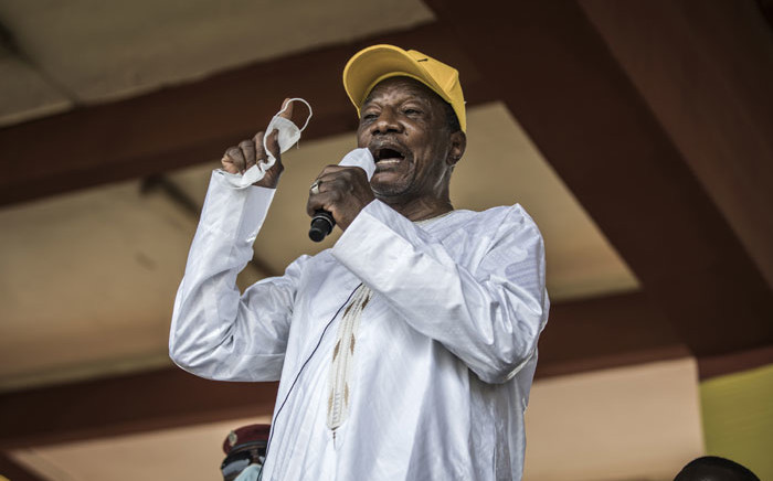 Current president and presidential candidate of Guinea, Alpha Conde, addresses his supporters at a campaign rally in Conakry on 16 October 2020. Picture: AFP