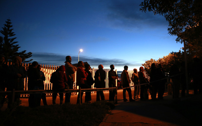 EARLY BIRDS: Cape Town residents join the queue at a local polling station during the early hours of the morning on 7 May, 2014. Picture: AFP