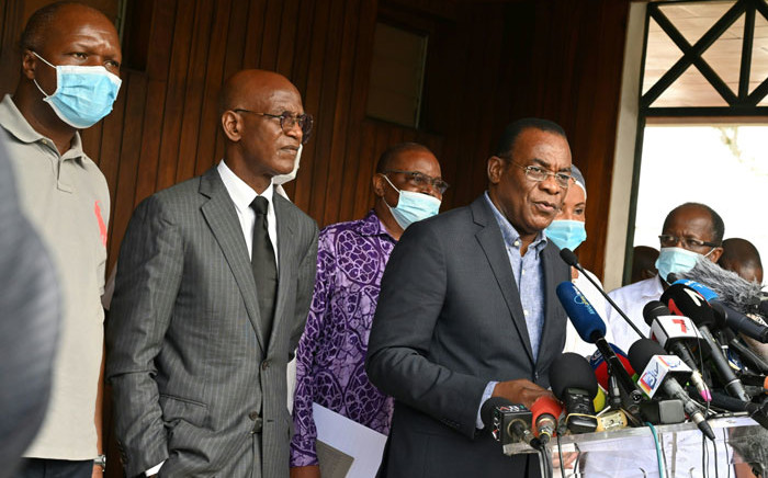 Ivorian opposition spokesperson and candidate Pascal Affi N'Guessan (R) speaks during a press conference next to Mamadou Koulibaly (2nd L) and Albert Mabri Toikeuse (L) to call for 'civilian transition' in Ivory Coast on 1 November 2020 in Abidjan. Picture: AFP