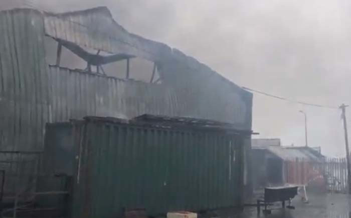 A view of the building that was set alight during protests in Hout Bay, Cape Town. Picture: EWN.