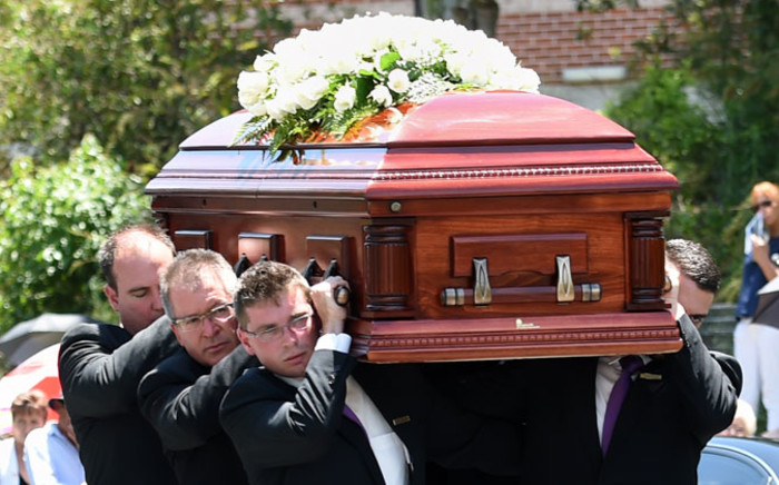 Pallbearers carry the coffin of Australian batsman Phillip Hughes ahead of his funeral in his home town of Macksville in northern New South Wales on 3 December, 2014. Picture: AFP