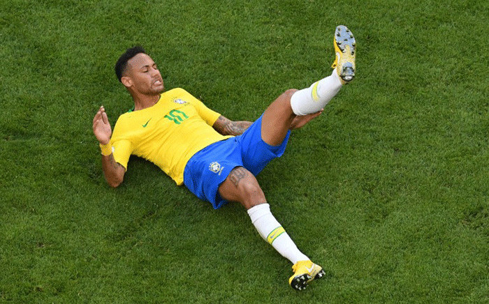 FILE: Brazil's forward Neymar falls on the ground during the Russia 2018 World Cup round of 16 football match between Brazil and Mexico at the Samara Arena in Samara on 2 July 2018. Picture: AFP.