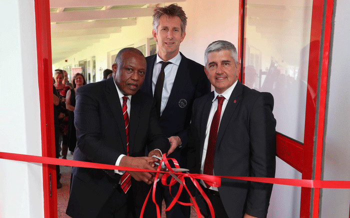 Premier Soccer League chairman Dr Irvin Khoza (R), Ajax Amsterdam CEO Edwin van der Sar (C), Ajax Cape Town chairperson Ari Efstathiou (L) officially open the Ajax Lambda Institute. Picture: @ajaxcapetown/Twitter.