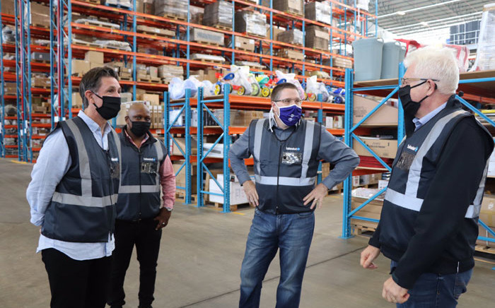 Western Cape Premier Alan Winde (right) and MEC of Finance & Economic Opportunities, David Maynier (centre) visit the Takealot depot in Milnerton on 11 May 2020 to inspect their COVID-19 hygiene measures. Picture: @alanwinde/Twitter