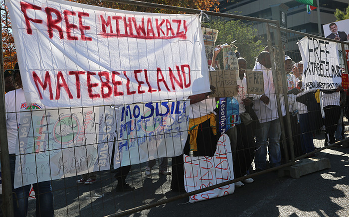 Several civil society groups from countries including Egypt, Lesotho and Zimbabwe demonstrated outside the Sandton Convention Centre on 14 June. Picture: Reinart Toerien/EWN.