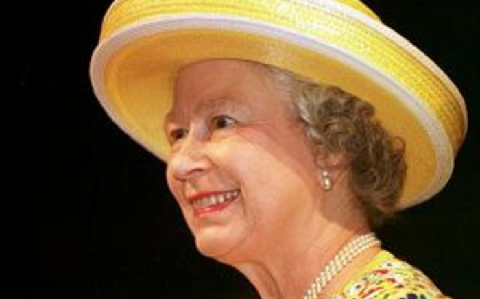 """Queen Elizabeth II smiles at the Stratford Theatre as watches Shakespeare's """"The Taming Of The Shrew"""" in Ontario, Canada. Picture: AFP"""