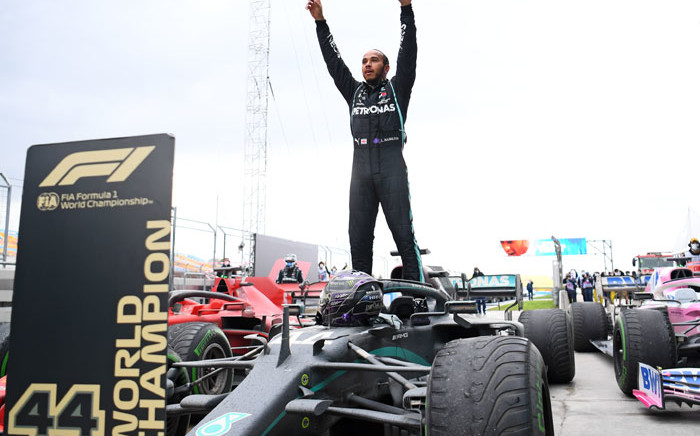 FILE: Mercedes' British driver Lewis Hamilton reacts as he gets out of his car after winning the Turkish Formula One Grand Prix at the Intercity Istanbul Park circuit in Istanbul on 15 November 2020. Lewis Hamilton won the race to seal his 7th World Championship. Picture: AFP.