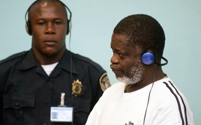 FILE: Augustine Gbao (R), one of the three rebel leaders convicted by the war court for Sierra Leone, stands during his trial on 8 April 2009 in Freetown. Picture: AFP