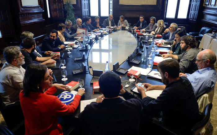 President of the Catalan parliament Carme Forcadell (C) attends a meeting with parliament representatives at the Parliament in Barcelona on 4 October 2017. Picture: AFP