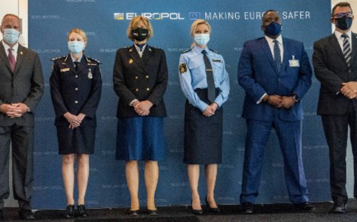 (L to R) Drug Enforcement Administration Deputy Chief of Operations Matthew Donahue, Australian Federal Police Commander, Jennifer Hurst, Chief Constable of the Netherlands Police's Central Unit Jannine van den Berg, Police Commissioner, Head of Intelligence of the Swedish Police Linda H Staaf, Assistant Director, Criminal Investigative Division, US Federal Bureau of Investigation Calvin Shivers and Europol's Deputy Executive Director Jean-Philippe Lecouffe pose after a press conference, on 8 June 2021 in The Hague. Police arrested 800 people in a huge global sting involving encrypted phones used by criminals that were secretly planted by law enforcement agencies, the EU police agency Europol said on 8 June 2021. Picture: Jerry Lampen/AFP