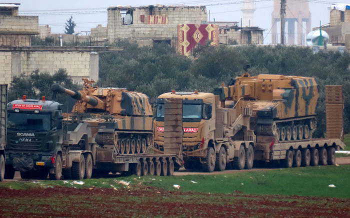 Turkish military vehicles are pictured in the town of Binnish in Syria's northwestern province of Idlib, near the Syria-Turkey border on 12 February 2020. Picture: AFP.