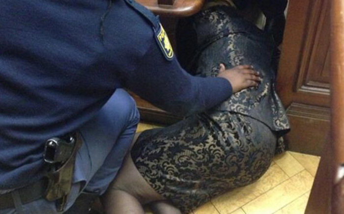 Thandi Maqubela faints while talking to her lawyer during the murder trial of her husband, acting Judge Patrick Maqubela. Picture: Rahima Essop/EWN.