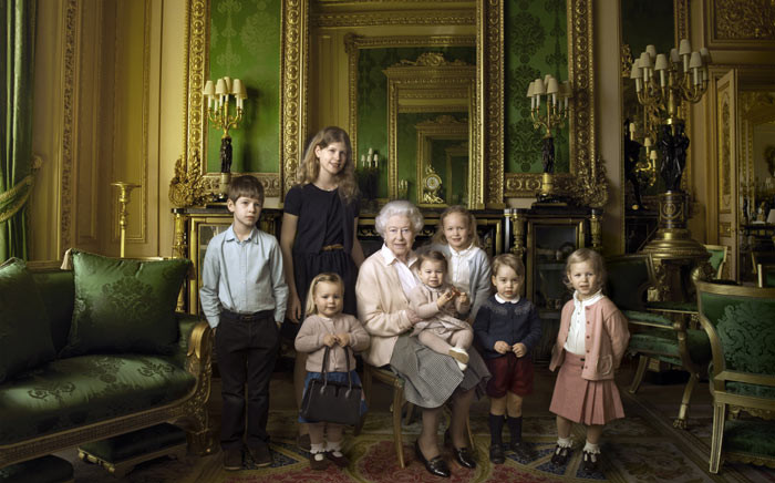This handout portrait picture taken by US photographer Annie Liebovitz shows Queen Elizabeth II (C) posing with her two grandchildren, James, Viscount Severn (L) and Lady Louise (2L) and her five great-grandchildren Mia Tindall (holding handbag), Savannah Philipps (3R), Isla Phillips (R), Prince George (2R) and Princess Charlotte (C) in the Green Drawing room at Windsor Castle in Windsor. Picture: AFP.