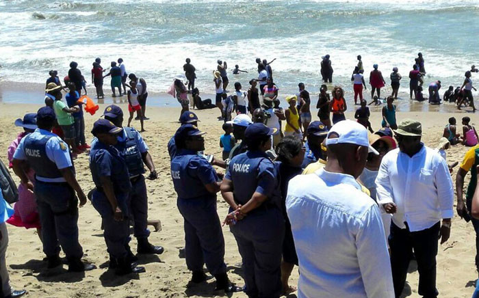 The nation's beaches are packed, as thousands flock to the ocean for the traditional New Year's Day festivities. Picture: @SAPoliceService via Twitter.