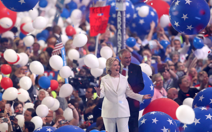 Democratic presidential candidate Hillary Clinton and US Vice President nominee Tim Kaine acknowledge the crowd at the end on the fourth day of the Democratic National Convention at the Wells Fargo Center, 28 July, 2016 in Philadelphia, Pennsylvania. Picture: AFP.