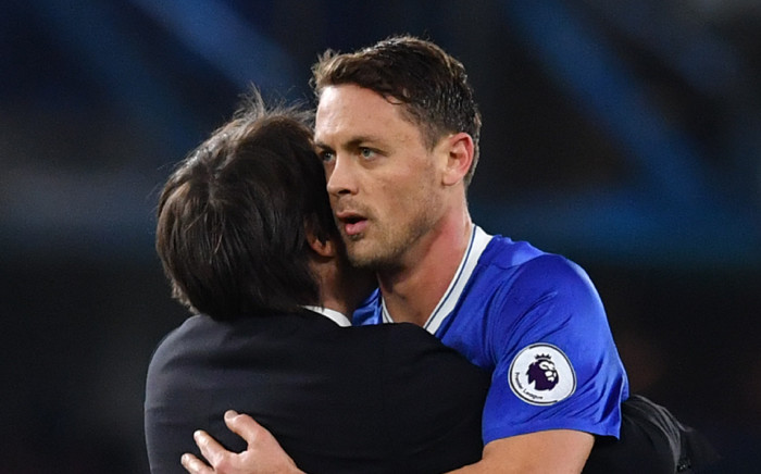 Chelsea's Italian head coach Antonio Conte congratulates Chelsea's Serbian midfielder Nemanja Matic at the end of the English Premier League football match between Chelsea and Tottenham Hotspur at Stamford Bridge in London on 26 November, 2016. Picture: AFP.