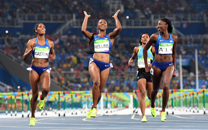 Gold medallist USA's Brianna Rollins (2ndL) celebrates as she crosses the finish line ahead of silver medallist USA's Nia Ali (R) and bronze medallist USA's Kristi Castlin (L) to win the Women's 100m Hurdles Final during the athletics event at the Rio 2016 Olympic Games at the Olympic Stadium in Rio de Janeiro on 17 August  2016. Picture: AFP.