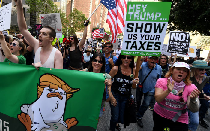 """Protestors take part in the """"Tax March"""" to call on US President Donald Trump to release his tax records in Los Angeles, California on April 15, 2017. Picture: AFP"""
