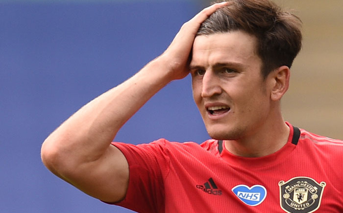 FILE: Manchester United defender Harry Maguire reacts during the English Premier League football match between Leicester City and Manchester United at King Power Stadium in Leicester, central England on 26 July 2020. Picture: AFP