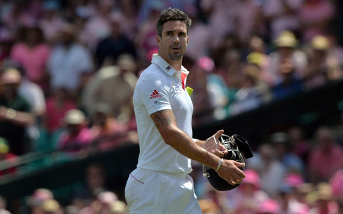 FILE: Former England's batsman Kevin Pietersen walks back towards the dressing room following his dismissal off the bowling of Ryan Harris on the third day of the fifth Ashes cricket Test at the Sydney Cricket Ground on  5 January, 2014. Picture: AFP