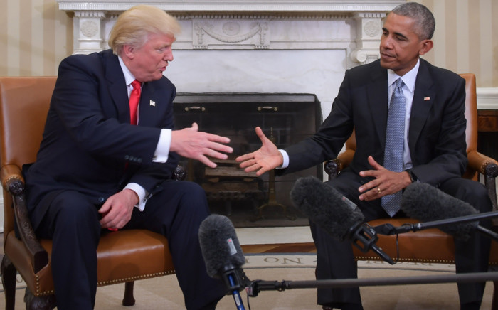 US President Barack Obama and Republican President-elect Donald Trump shake hands during a transition planning meeting in the Oval Office at the White House on November 10, 2016 in Washington,DC. Picture: AFP