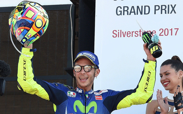 FILE: MotoGP's Italian rider Valentino Rossi celebrates third place on the podium after the MotoGP race of the British Grand Prix at Silverstone circuit in Northamptonshire, southern England, on 27 August 2017. Picture: AFP.