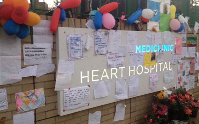 Flowers and messages of well wishes posted on the wall at Mediclinic Heart Hospital in Pretoria where the former President Nelson Mandela is receiving treatment. Picture: EWN