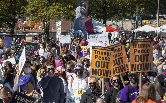 Protesters attend the Women's March at Freedom Plaza on 17 October 2020 in Washington, DC. Demonstrators took to the streets in honour of the late Supreme Court Justice Ruth Bader Ginsburg and to protest President Donald Trump's nomination of Judge Amy Coney Barrett to the Supreme Court before the November election. Picture: AFP