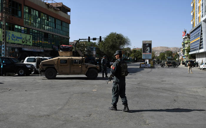 FILE: Afghan security personnel stand guard near the site of a suicide attack in Kabul on 25 August 2017. Picture: AFP