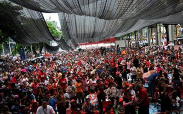 """Thai """"Red Shirt"""" anti-government protesters during a rally held inside their fortified camp in the central financial district in downtown Bangkok. Picture: AFP."""