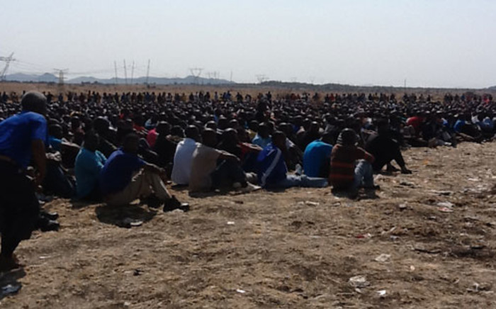 Marikana miners wait for religious leaders to address them. Picture: Andrea van Wyk/EWN.
