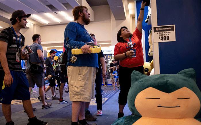 FILE: People peruse Pokemon products during the first day of the 2019 Pokemon World Championships at the Washington Convention Centre 16 August 2019, in Washington, DC. Picture: AFP