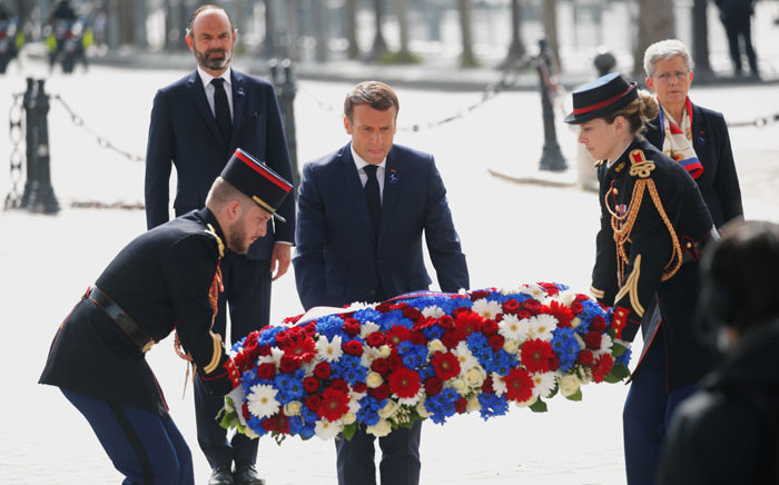 French President Emmanuel Macron lays a wreath of flowers during a ceremony to mark the end of World War II at the Arc de Triomphe in Paris on 8 May 2020. Picture: AFP