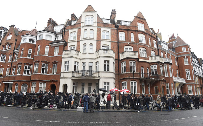Members of the media stand outside the Ecuadorian Embassy where Julian Assange has sought political asylum, in London, on 5 February 2016. Picture: EPA/Facundo Arrizabalaga.