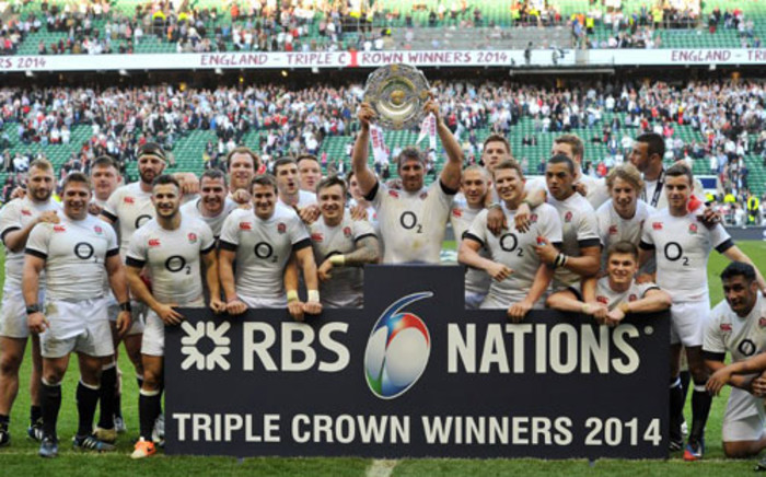 England flanker Chris Robshaw holds aloft the Triple Crown Trophy following the Six Nations International rugby Union match between England and Wales at Twickenham, West London on March 9, 2014. England won 29-18.