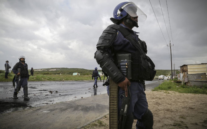 Police arrested several people after protesters opposed a move to remove squatters of city-owned land in Enkanini on 19 August 2014. Picture: Thomas Holder/EWN.