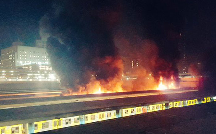 Metrorail train carriages on fire at the Cape Town Station on 09 April 2016. Picture: Twitter: @CapeTalk