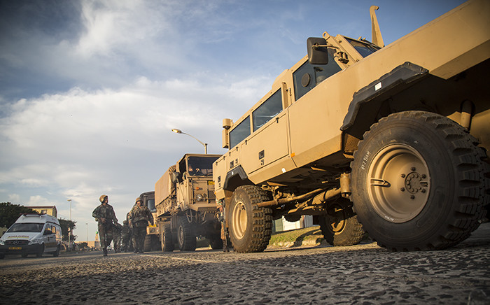 FILE: South African National Defence Force vehicles line a street in Ottery after the completion of a Fiela Operation raid on 22 May 2015. Picture: Thomas Holder/EWN