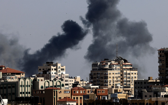 Smoke billows from Israeli air strikes in the Gaza Strip, controlled by the Palestinian Islamist movement Hamas, on May 11, 2021. Israel and Hamas exchanged heavy fire, in a dramatic escalation between the bitter foes sparked by unrest at Jerusalem's flashpoint Al-Aqsa Mosque compound. Picture: AFP