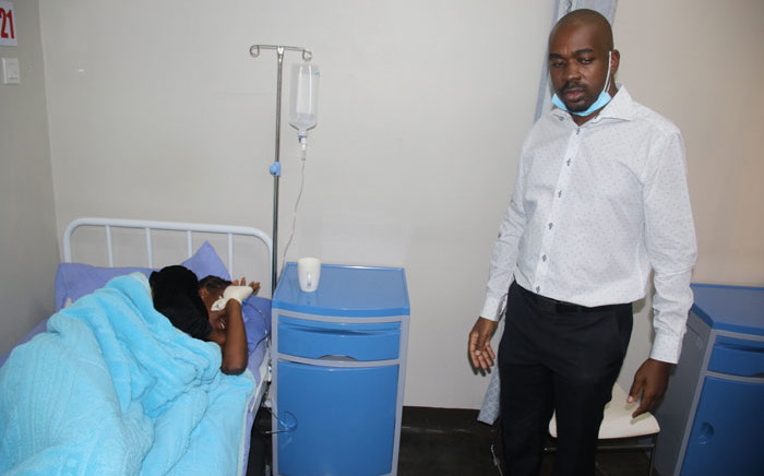 FILE: MDC leader Nelson Chamisa (right) visits one of the three youth leaders in hospital on 15 May 2020. Picture: @mdczimbabwe/Twitter