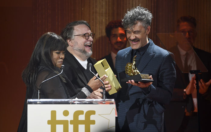 (L-R) Chaz Ebert and Guillermo del Toro present the TIFF Ebert Director Award to Taika Waititi during the 2019 Toronto International Film Festival TIFF Tribute Gala at The Fairmont Royal York Hotel on 9 September 2019 in Toronto, Canada. Picture: AFP
