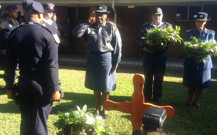 FILE: National Police Commissioner Riah Phiyega pays respect to murdered officers on 5 August 2013. Picture: Lauren Isaacs/EWN.