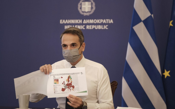 Greek Prime Minister Kyriakos Mitsotakis during a televised address in Athens, held to announce a national lockdown to curb the spread of COVID-19. Picture: AFP.