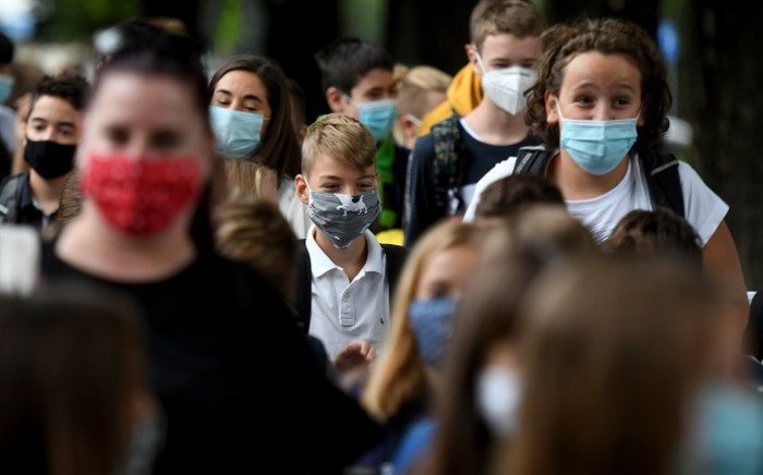 FILE: Children wearing protective face masks arrive at school on 7 September 2020 in Zagreb. School started in Croatia today with the implementation of epidemiological measures to combat the coronavirus pandemic. Picture: AFP.