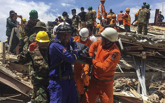 Rescue workers remove a victim from the debris after an under-construction building collapsed in Sihanoukville on 22 June 2019. Picture: AFP