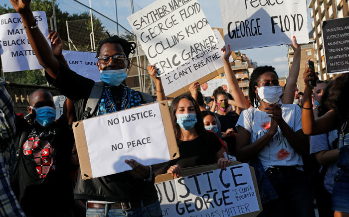 People take part in a protest over the police killing of George Floyd in the USA, on 1 June 2020 in Barcelona. Picture: AFP