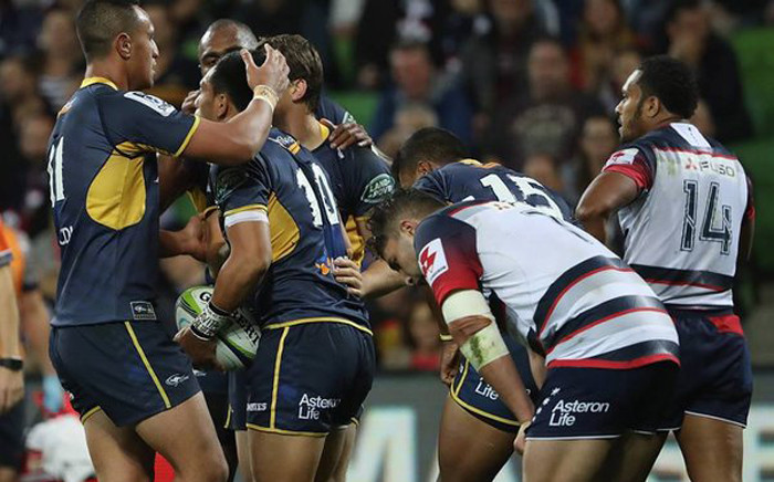 ACT Brumbies players celebrate after beating the Melbourne Rebels 30-22. Picture: Brumbies ‏@BrumbiesRugby.