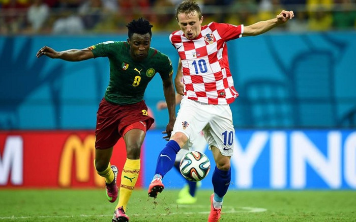 Cameroon midfielder Benjamin Moukandjo battles for the ball with Croatia midfielder Luka Modric. Picture: Facebook.com